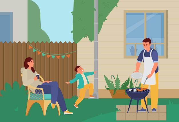 Famille ayant une soirée grill dans la cour
