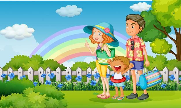 Famille dans le parc le jour de l'arc-en-ciel