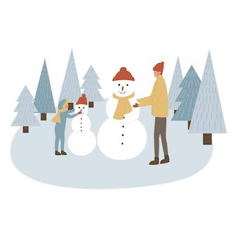 Famille faisant bonhomme de neige ensemble, père et fils et bonhomme de neige