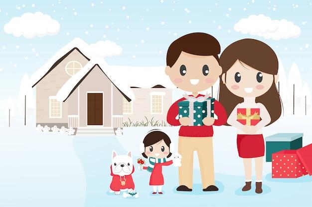 Famille heureuse avec bouledogue français pour animaux de compagnie le jour de noël enneigé