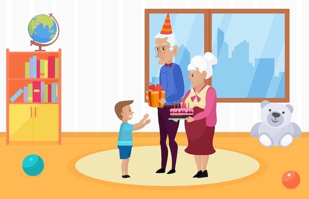 Une famille heureuse célèbre les enfants joyeux anniversaire grand-mère grand-père tenant un cadeau de gâteau