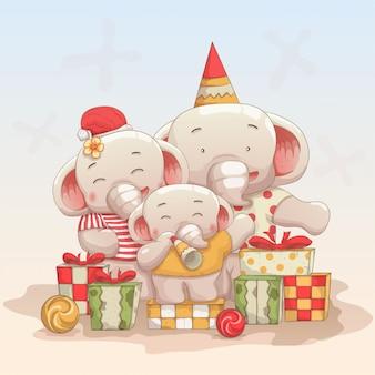 Famille heureuse d'éléphants fêter noël et le nouvel an