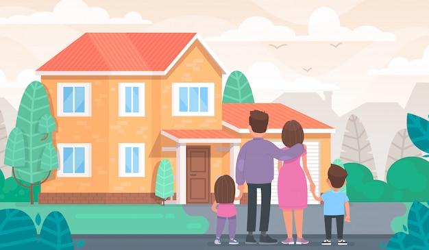 Une famille heureuse regarde sa nouvelle maison