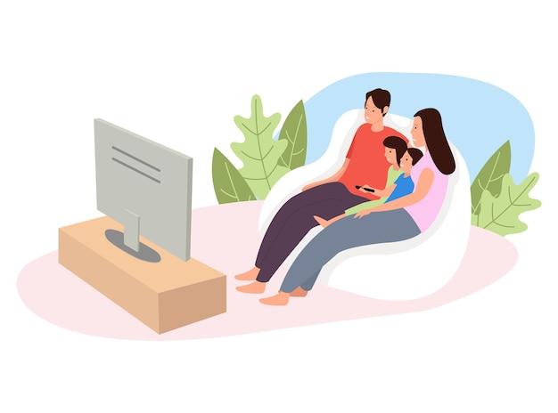Une famille heureuse regarde la télévision ensemble