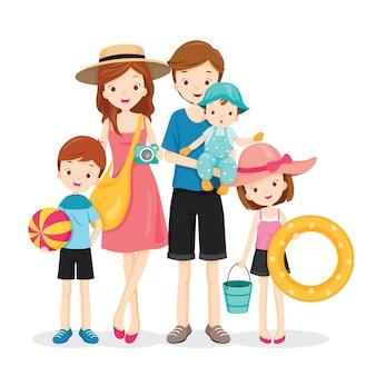 Famille heureuse avec voyage d'été, aller à la plage