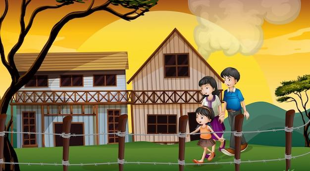 Une famille marchant devant les maisons en bois