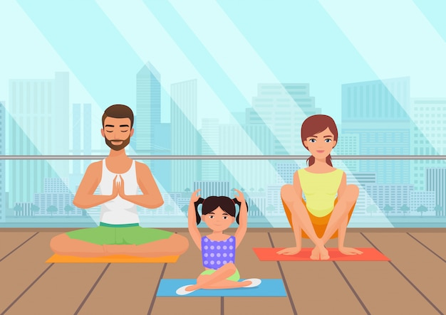 Famille méditant en salle de fitness