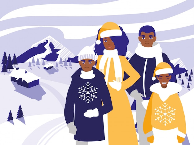 Famille noire avec des vêtements de noël dans un paysage d'hiver