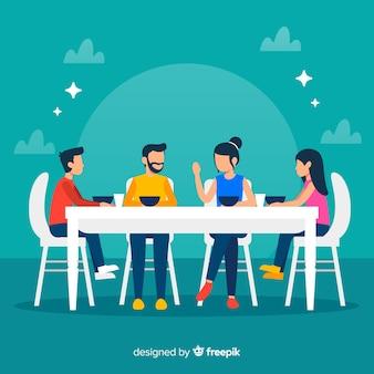 Famille plate assis autour d'une illustration de la table