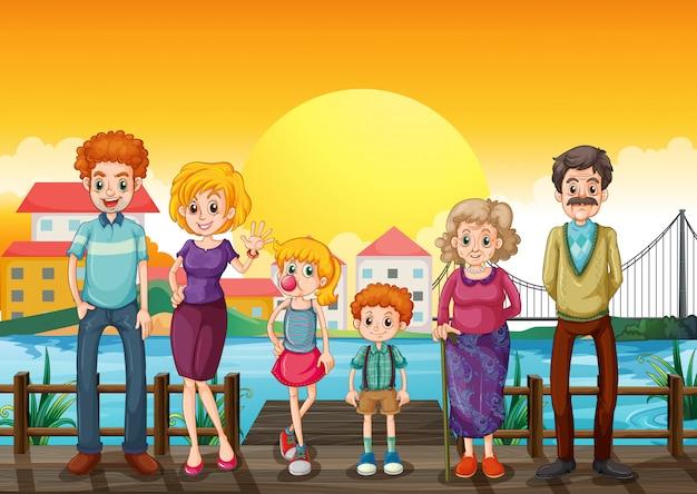 Une famille sur le pont de bois à travers le village
