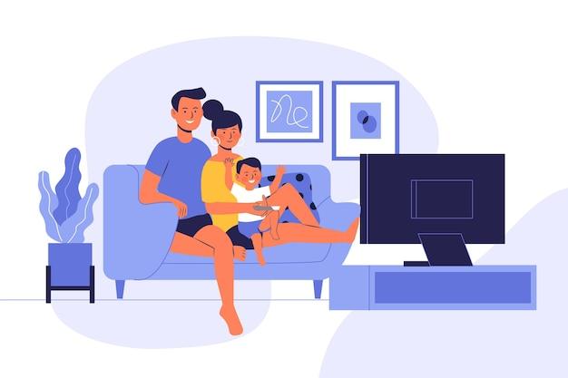 Famille regardant un film ensemble à la maison
