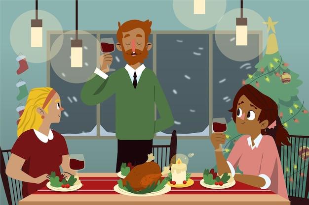 Famille servant le dîner dans la nuit de noël