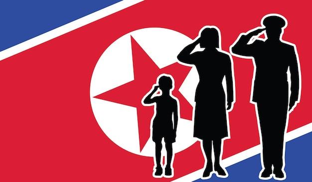 La famille de soldat de la corée du nord salue le fond de patriote