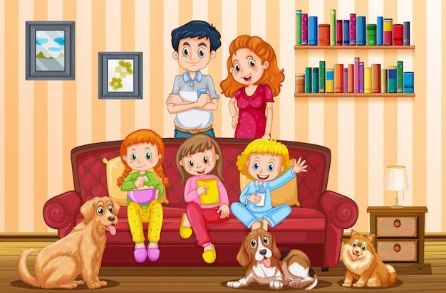 Famille avec trois filles et des chiens dans le salon