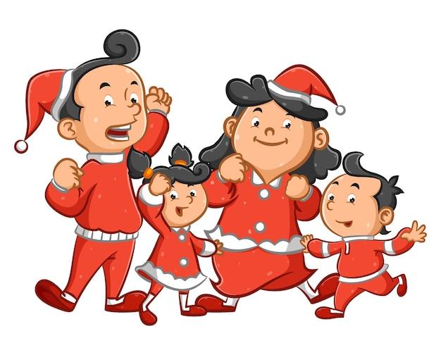Famille utilisant le costume rouge pour célébrer la nuit de noël