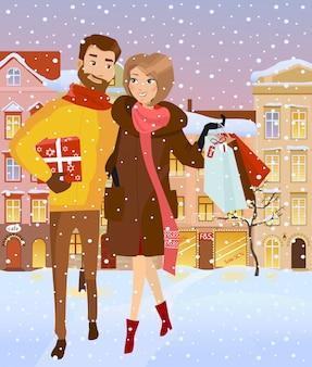 Famille avec des ventes à la rue d'hiver.