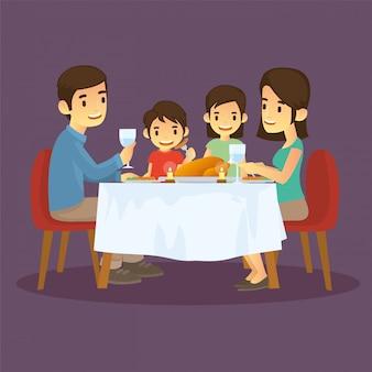 Les familles heureuses dînent au réveillon du nouvel an