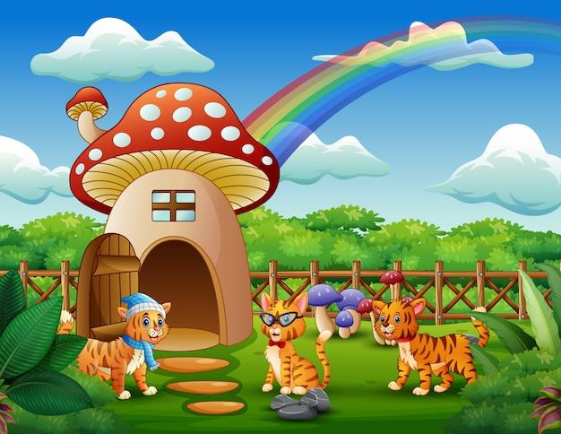 Fantaisie maison de champignon avec trois chats