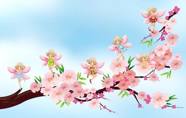 Fées volant sur une branche de fleur
