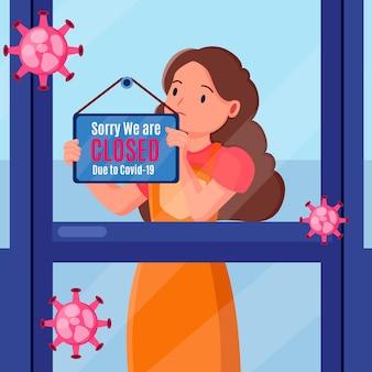 Femme accrochant une pancarte fermée en raison d'un coronavirus