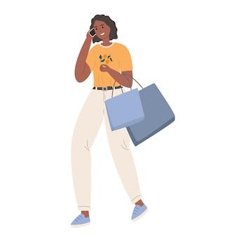 Femme avec achat parlant au téléphone