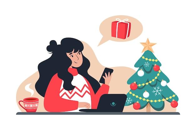 Une femme achète des cadeaux pour la famille dans la boutique en ligne, les achats en ligne du nouvel an et de noël à domicile