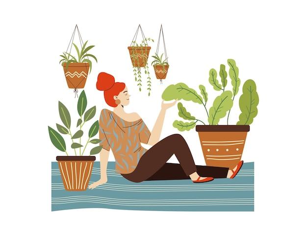 La femme admire les plantes d'intérieur assises sur le sol dans l'illustration vectorielle plane de la chambre