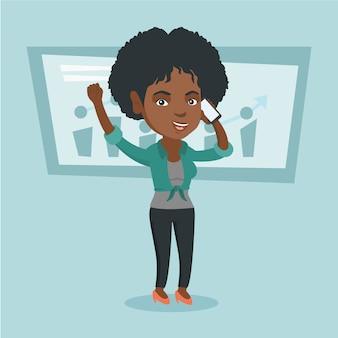 Femme d'affaires africaine parlant sur téléphone mobile.