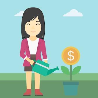 Femme d'affaires arrosant une fleur d'argent