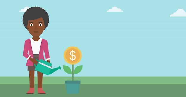Femme d'affaires arrosant une fleur d'argent.