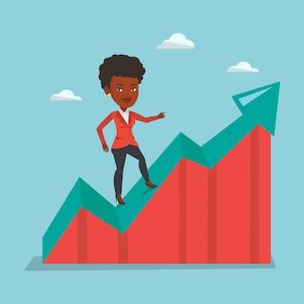 Femme d'affaires debout sur le graphique de la croissance.