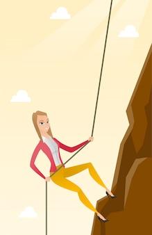 Femme d'affaires d'escalade sur la montagne.