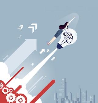 Femme d'affaires avec une fusée ampoule - concept d'affaires
