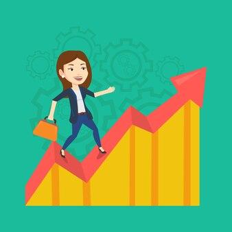 Femme d'affaires heureux debout sur le graphique des bénéfices.
