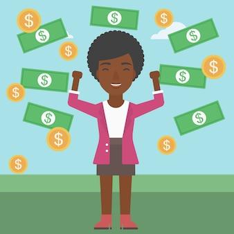 Femme d'affaires heureux sous une pluie d'argent.