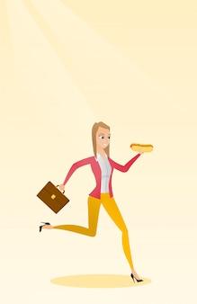 Femme affaires, manger, hot dog