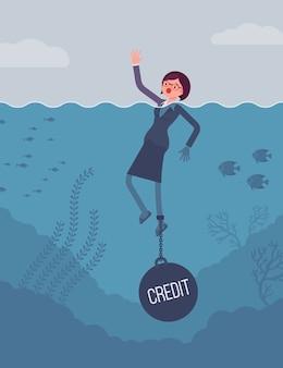 Femme d'affaires noyée enchaînée avec un poids de crédit