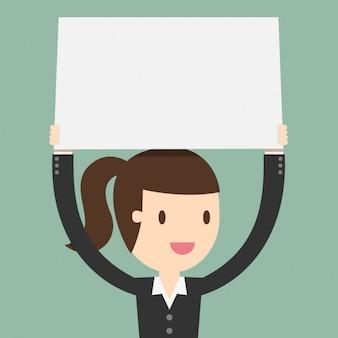 Femme d'affaires avec une pancarte en blanc
