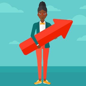 Femme d'affaires réussie avec la flèche vers le haut.