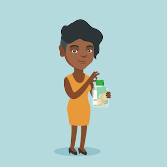 Femme africaine, mettre, dollar, dans, a, pot verre.