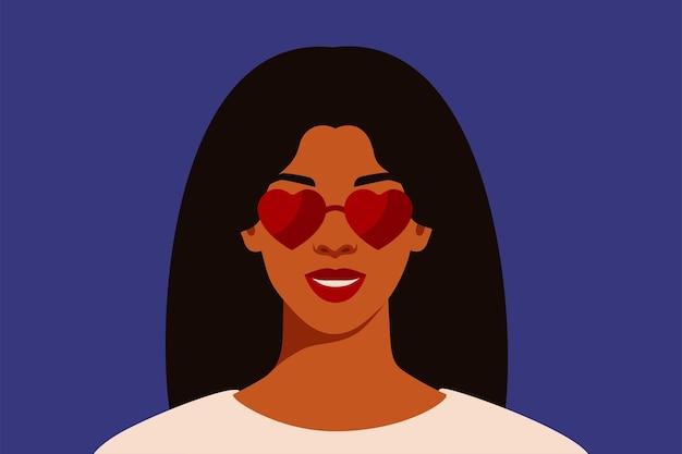 Femme afro-américaine aux cheveux noirs en forme de coeur de lunettes de soleil rouges avec reflet
