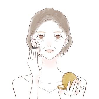 Femme d'âge moyen appliquant un fond de teint poudré au visage avec une bouffée. sur un fond blanc.