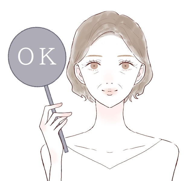 Femme d'âge moyen inging signe ok. sur un fond blanc.
