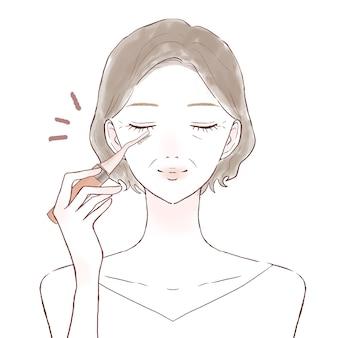 Femme d'âge moyen recourbant les cils avec un buehler chaud. sur un fond blanc.
