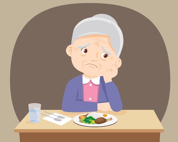 Femme âgée s'ennuie de nourriture