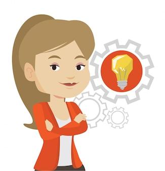 Femme avec ampoule idée entreprise engrenage.