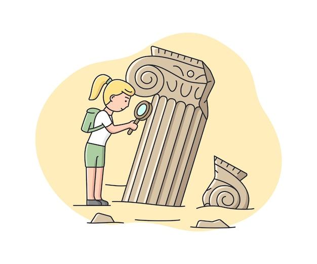Femme archéologue à la recherche sur de vieilles colonnes