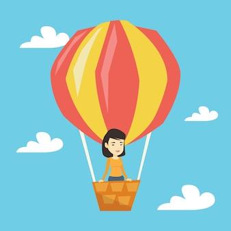 Femme asiatique volant en montgolfière.