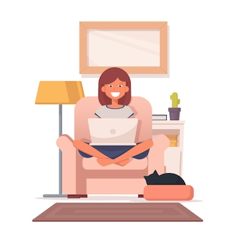 Une femme assise sur une chaise et travaille sur un ordinateur portable.
