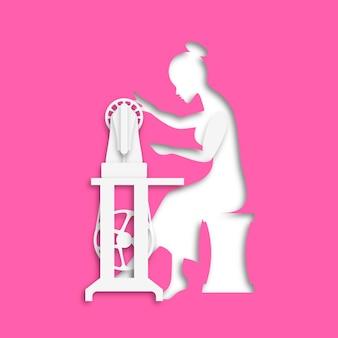 Femme assise avec une machine à coudre